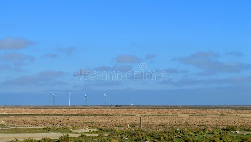 Wind generators along the road. Wind energy. Wind power. Wind power station. Clean nature, clean electricity. stock photo