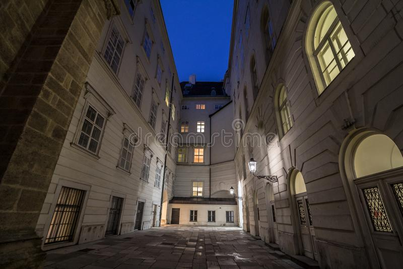 Narrow and dark medieval courtyard in the schweizerhof aisle of the Hofburg palace in Vienna, the former imperial castle residence royalty free stock photos