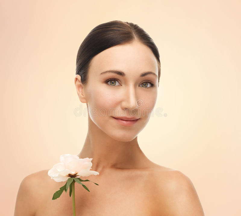 Picture of smiling woman with rose royalty free stock photos