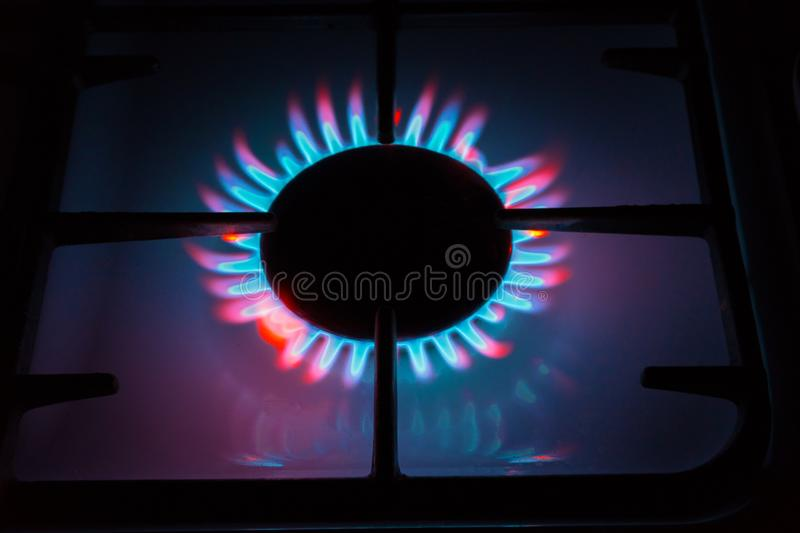 Picture something like burning gas coming from the gas burners. Multi-colored flame. royalty free stock image