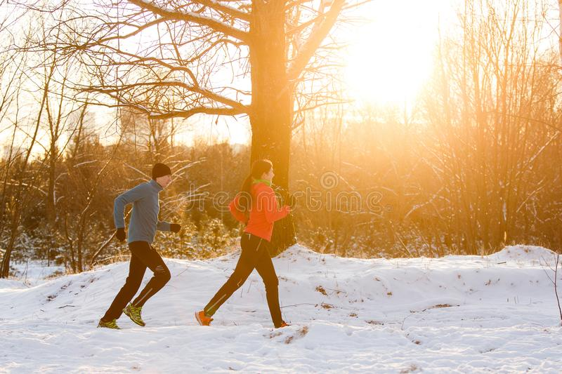 Picture of sports man and woman on morning run royalty free stock image
