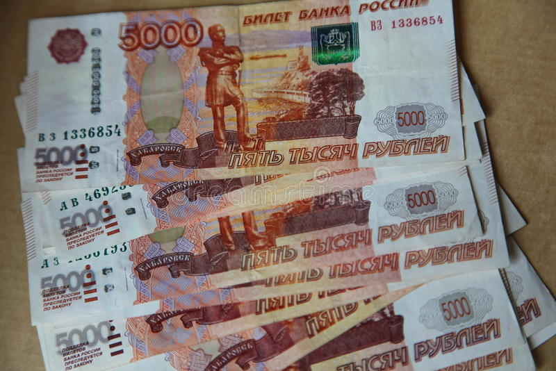 The picture spread out like a fan banknotes of the Central Bank of the Russian Federation with par value of 5 thousand rubles. The picture spread out like a fan stock images