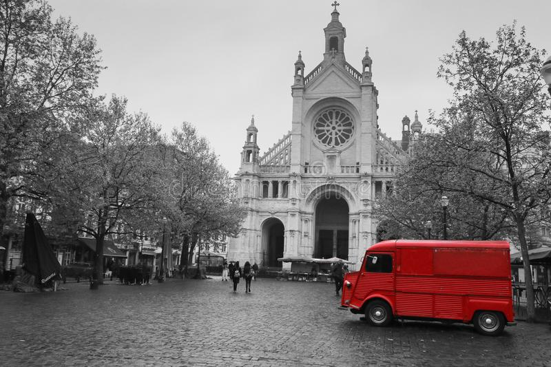 Old red van is standing in front of the cathedral. A picture from the square in Brussels, Belgium. The old red van is standing in front of the cathedral. The van royalty free stock photo