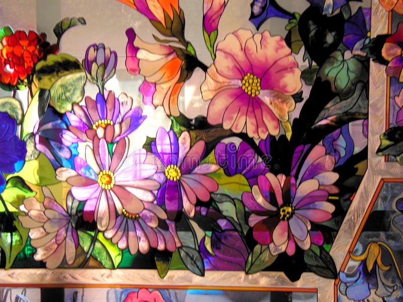 Stain Glass Window of Flowers. Picture of a stain glass window of colorful flowers royalty free stock photography
