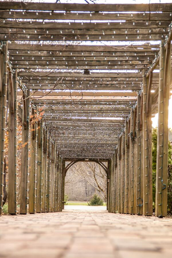 Stone pathway with a wooden frame and Christmas lights stock images