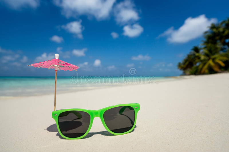Picture of sunglasses on the tropical beach, vacation. Traveller dreams concept royalty free stock photography