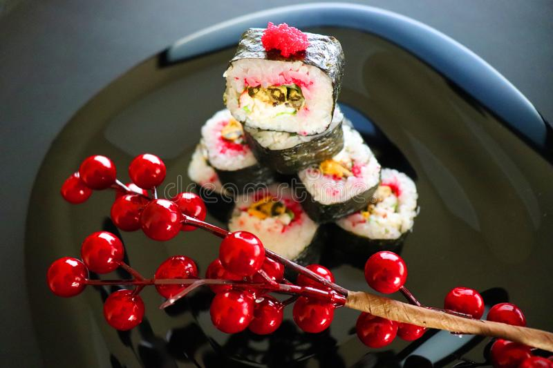 Japanese food. Christmas sushi. Sushi with tobiko caviar. Picture of sushi in an Asian style. Japanese food. traditional Japanese cuisine. Holiday photo royalty free stock image