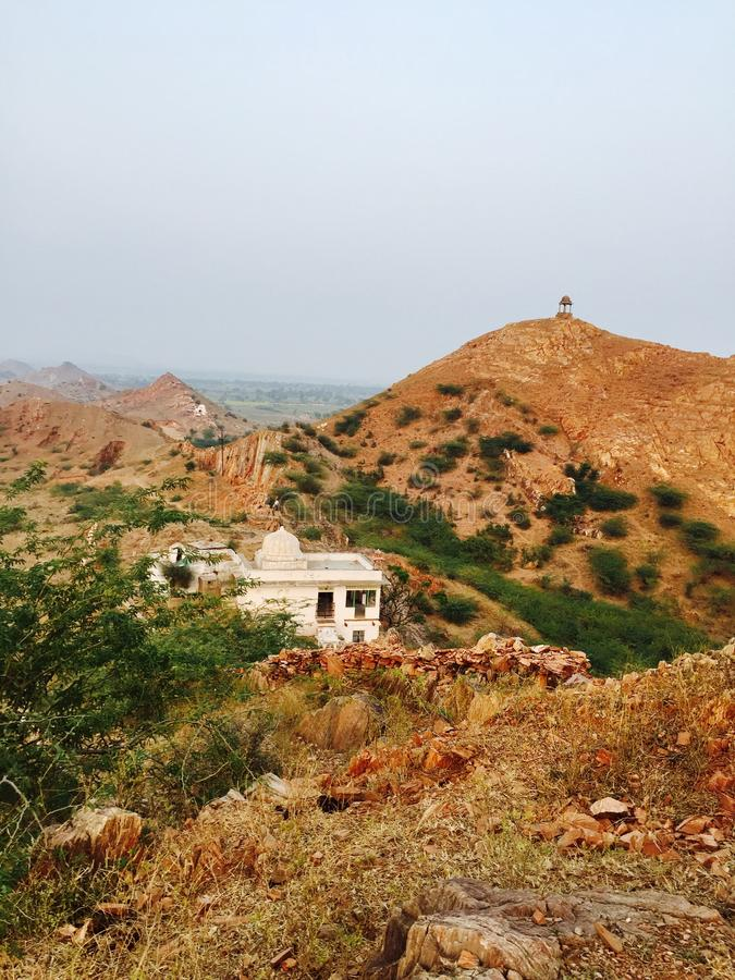 Mountainandtemplegreentree. Rajasthan banetha mountain natural picture temple background greentree forest stock photography