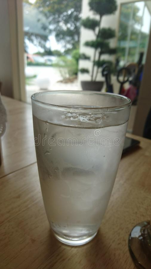A cup of cold water to chill royalty free stock images