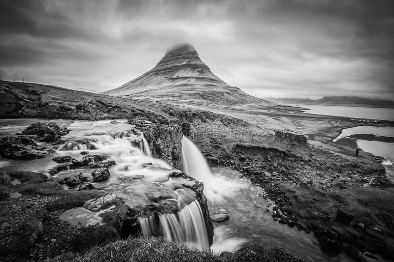 Majestic Kirkjufell and the Kirkjufellsfoss in West Iceland royalty free stock images