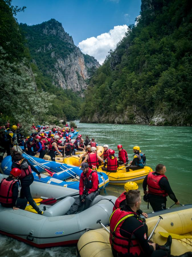Crowd on the rafting side stock photography