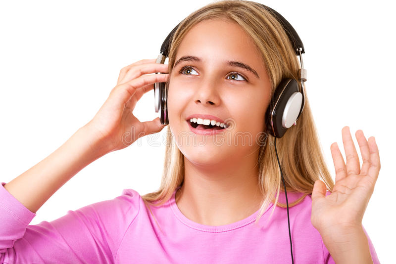 Picture of teenage lovely girl with headphones listening music. Over white background royalty free stock photo