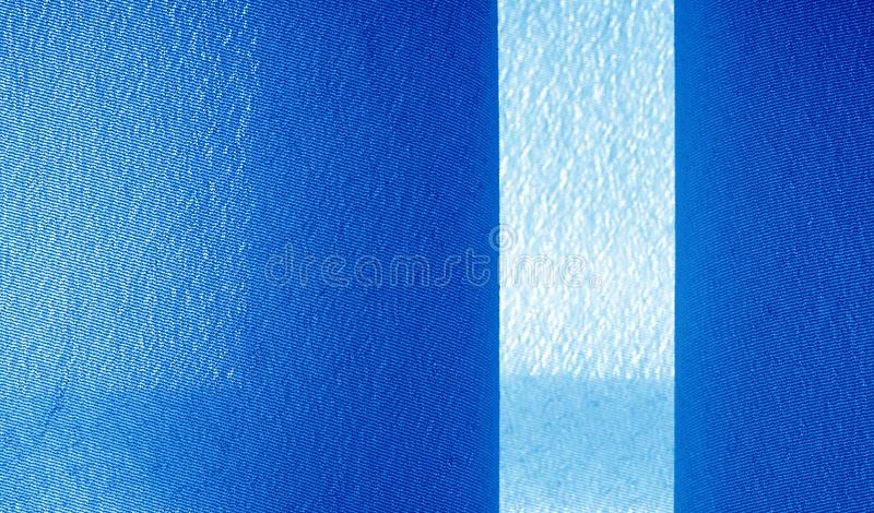 Picture. Texture, background. Blue sapphire silk fabric. This luxurious soft fabric has an ultra-soft and creamy surface with a. Diverse 10 mm pile of shades of stock image