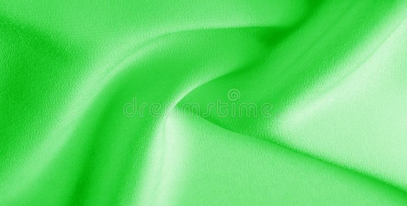 Picture. Texture, background. green emerald silk fabric. This medium / silky silk fabric has a wonderful shine with slight color. Variations to give the look a stock photos