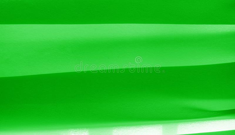 Picture. Texture, background. green emerald silk fabric. This medium / silky silk fabric has a wonderful shine with slight color. Variations to give the look a royalty free stock image