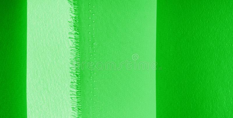 Picture. Texture, background. green emerald silk fabric. This medium / silky silk fabric has a wonderful shine with slight color. Variations to give the look a royalty free stock photo