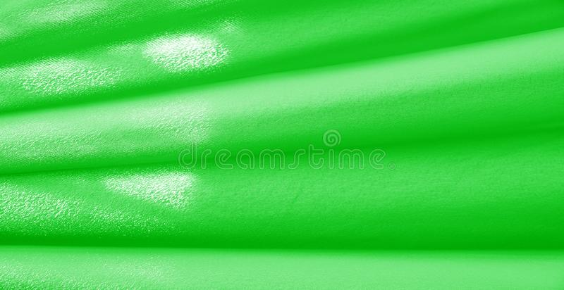 Picture. Texture, background. green emerald silk fabric. This medium / silky silk fabric has a wonderful shine with slight color. Variations to give the look a royalty free illustration