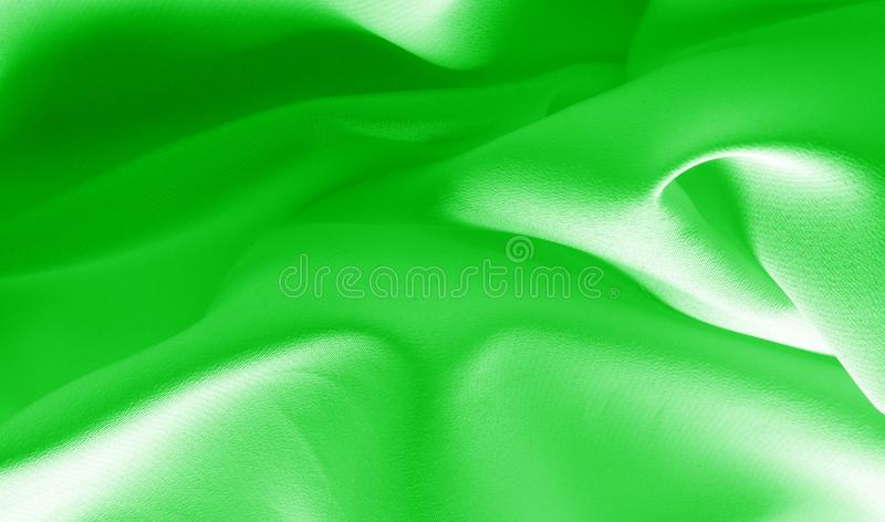 Picture. Texture, background. green emerald silk fabric. This medium / silky silk fabric has a wonderful shine with slight color. Variations to give the look a royalty free stock photos