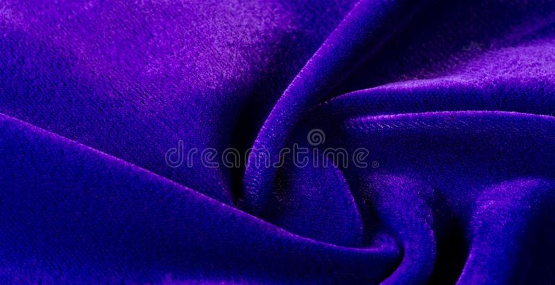Picture. Texture, background. The velvet fabric is blue, the rich, rich color and luster of this luxurious velvet will add royalty free stock photography