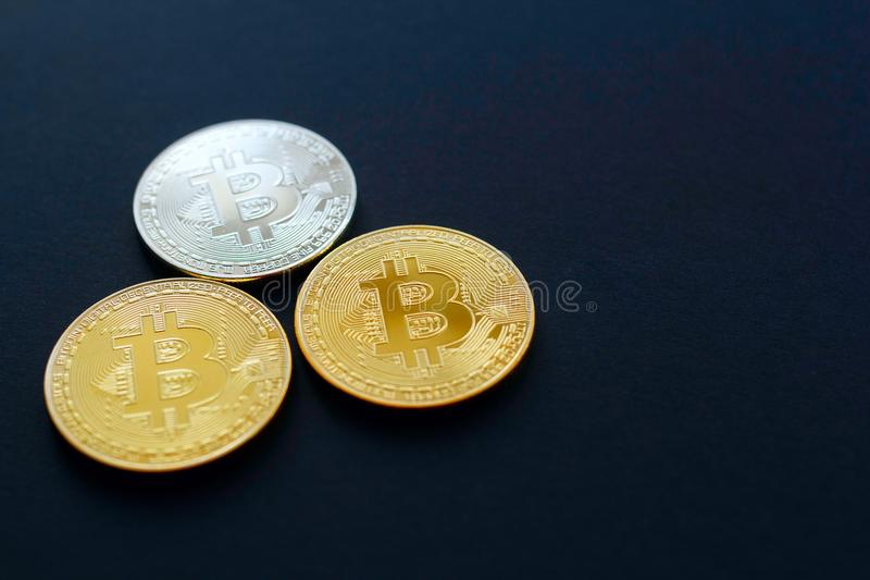 Picture of three gold bitcoin over black background. Digital mon royalty free stock photos
