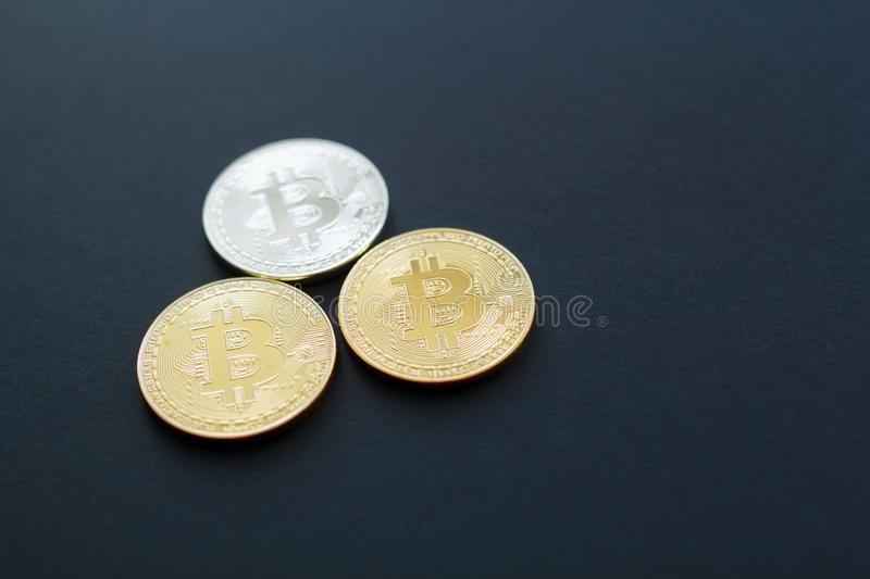 Picture of gold bitcoin over black background. Digital money con stock images