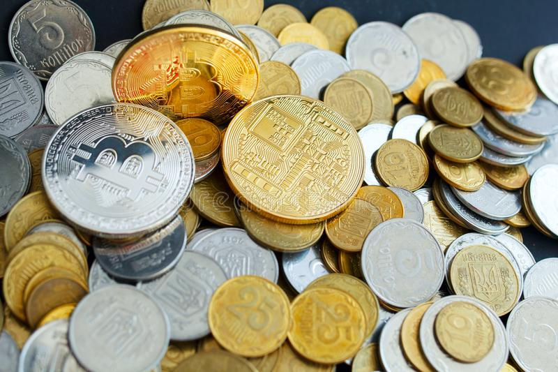Picture of three gold bitcoin over golden money. Digital money c royalty free stock photography