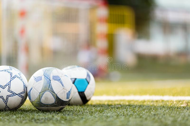 Picture of three soccer balls on field royalty free stock images