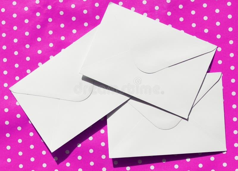 Picture of three white envelopes stock photos