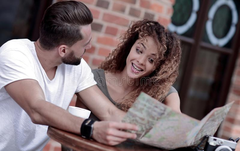 A picture of tourists looking at map in a cafe royalty free stock photography