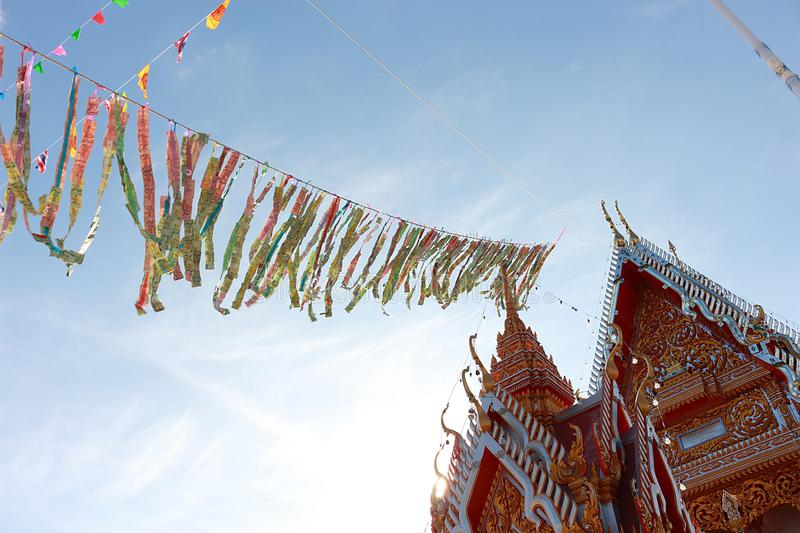 The merit of Thai people 2. In this picture, It is a tradition of Thai people, Buddhist merit., Banknotes are sewn together, The flag is mixed together, Sorted stock photos