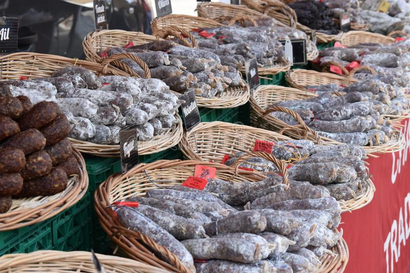 Picture from a traditional morning fresh food market with a large selection of traditional salamis royalty free stock photo