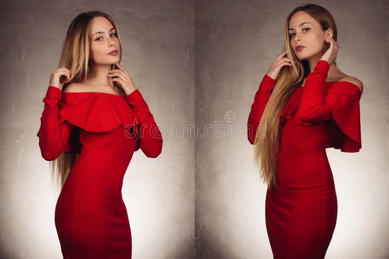Picture of a two charming young girls in red dress royalty free stock photography