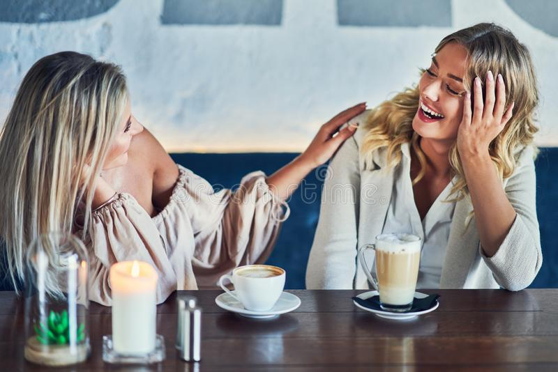Two girl friends eating lunch in restaurant. Picture of two girl friends eating lunch in restaurant stock photo