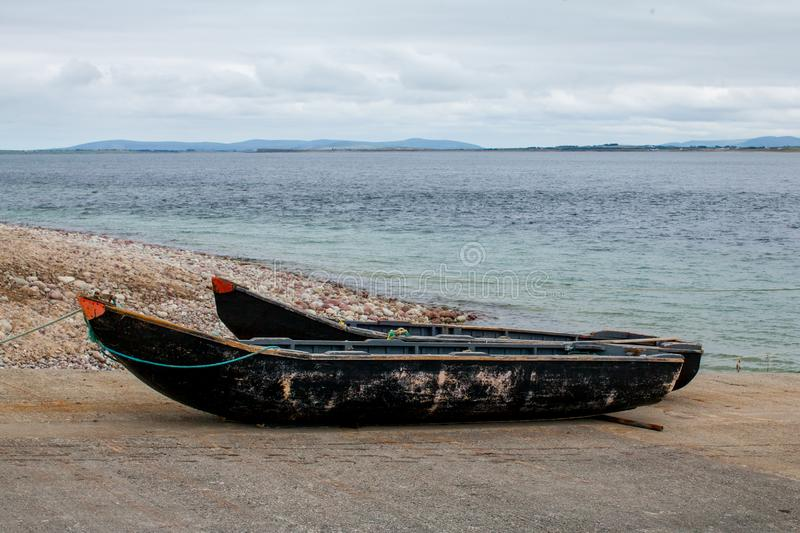 Two wooden Currach boats royalty free stock photos