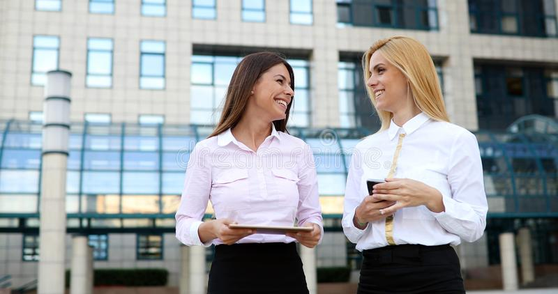 Picture of two young beautiful women as business partners royalty free stock images