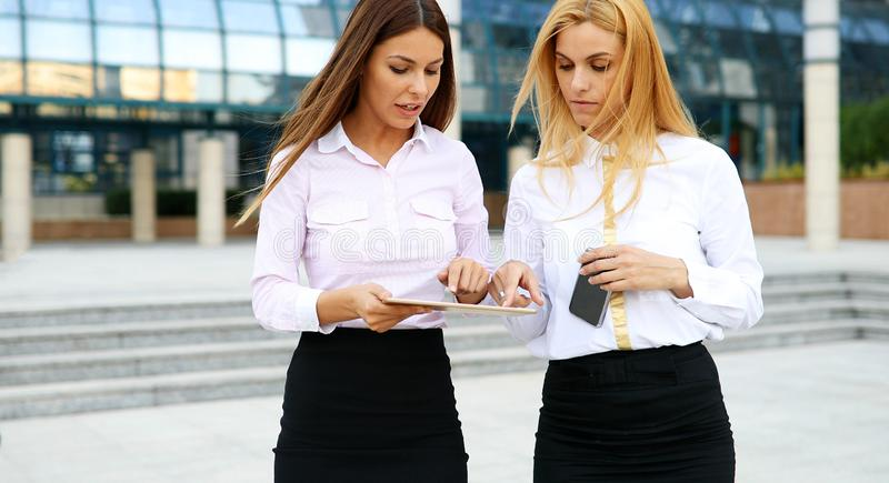 Picture of two young beautiful women as business partners stock photography