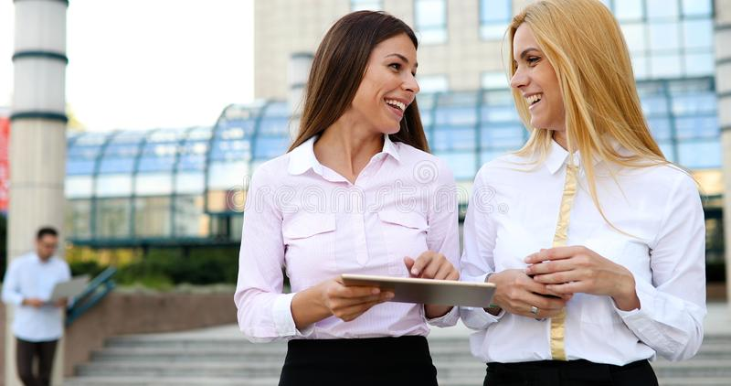 Picture of two young beautiful women as business partners royalty free stock photography