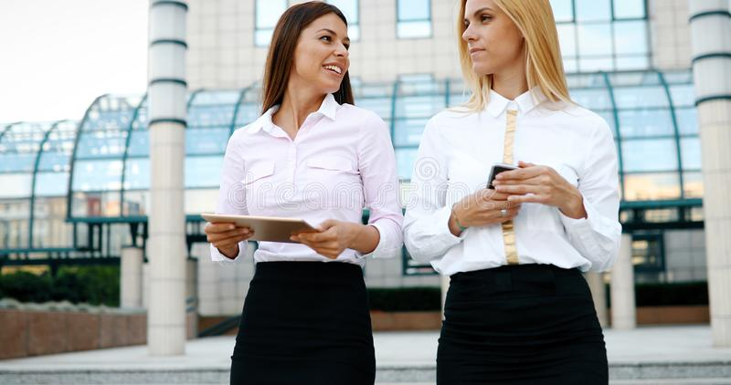 Picture of two young beautiful women as business partners stock photos