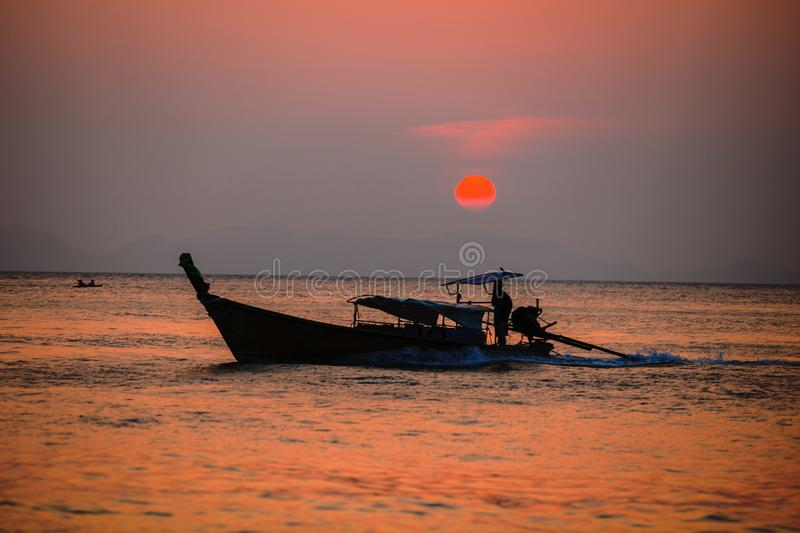 Picture of typical fisher man boat in sunset. Thailand. Picture of typical fisher man boat in sunset. Krabi. Thailand stock photos