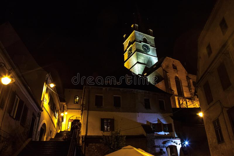 Upper town of Sibiu, in Transylvania, in the evening in a medieval street of the city. stock photography