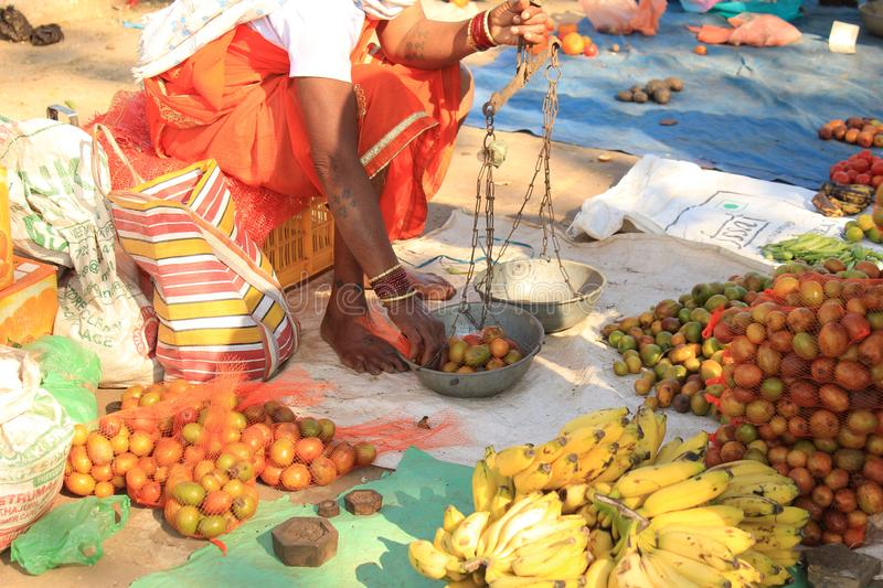 Plum Selling. Picture of a Vendor selling plum at Street of Chitrakot Waterfall in day time of summer in jagdalpur city of bastar district in chhattisgarh state royalty free stock photos