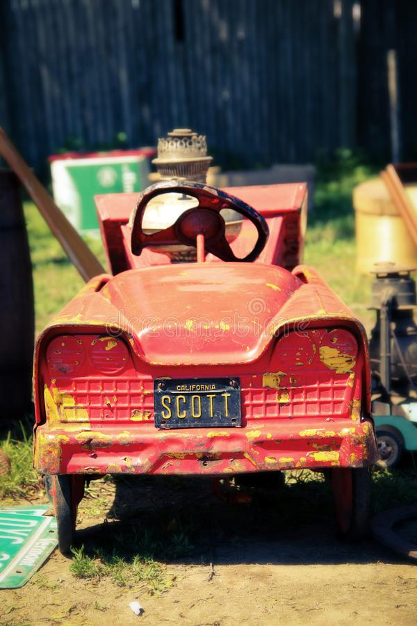 Vintage red toy car. A picture of a vintage red toy car at a flea market stock photos