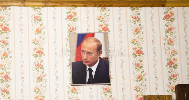 The picture of vladimir putin in local family,suzdal,russian federation. The picture of vladimir putin in local family is taken in suzdal,russian federation stock photo