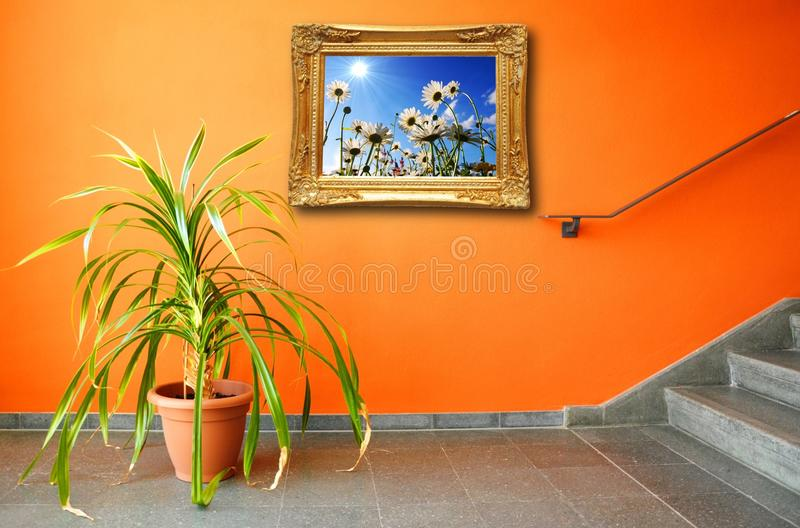 Download Picture On A Wall And Plant Stock Image - Image: 14380567