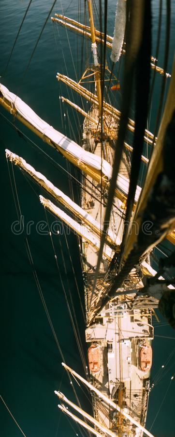 View from the top of the first main mast of the four-masted barque tall ship went to drift in calm ocean. stock photo