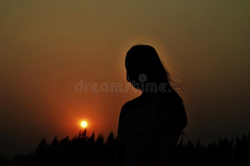 Sunset with sillhoutte royalty free stock photos
