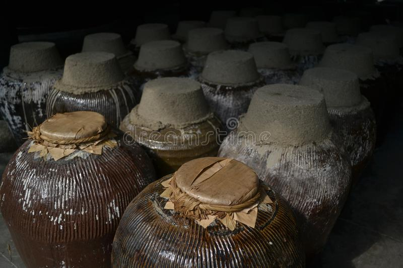 A group of sealed ceramic beer barrel, stored in a beer factory in Zhou Zhuang, China. This picture was taken in Zhou Zhuang, a water town in China royalty free stock photography