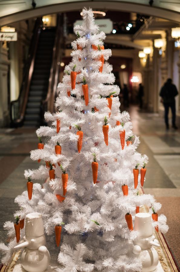 Picture of white Christmas tree decorated with carrots royalty free stock photos