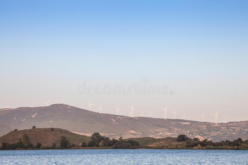 Romanian Wind Farm with Wind Turbines and windmills facing the Danube river, in the Iron Gates valley royalty free stock image
