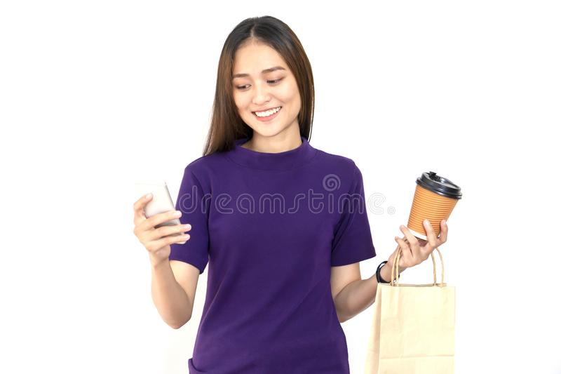 Picture of woman holding shopping bag, coffee cup and looking at royalty free stock photo
